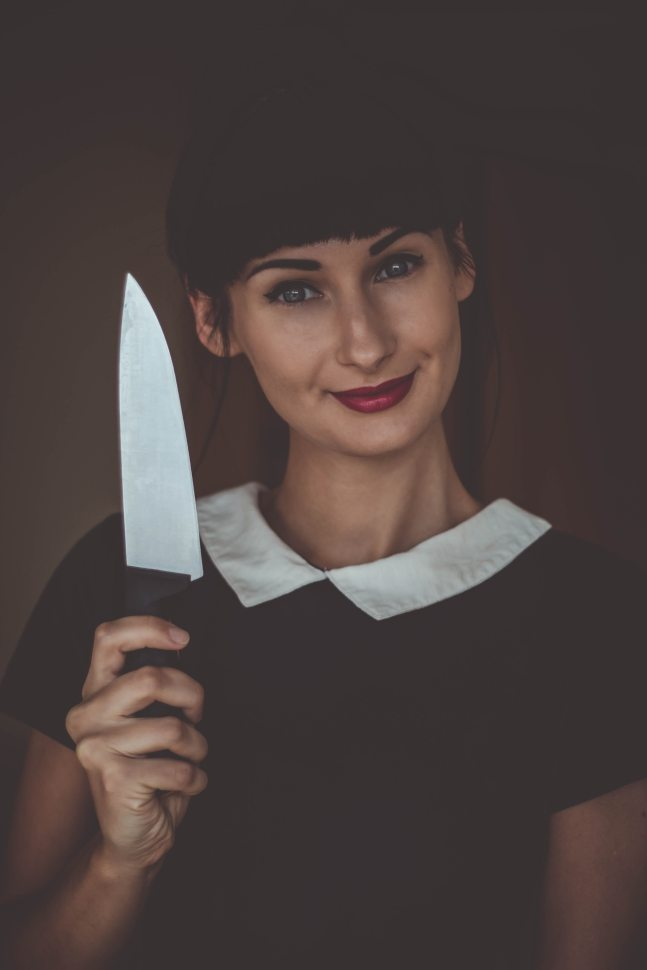 woman smiling with knife