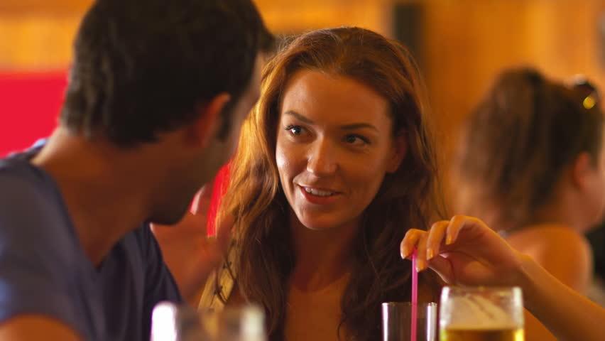 Couple Flirting At Bar